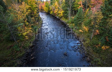 Michigan Wilderness River Overlook. Sturgeon River winds through the autumn wilderness of Michigan.