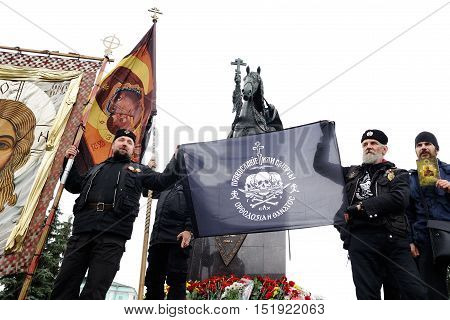 Orel Russia - October 14 2016: Ivan the Terrible monument opening ceremony. Union of Orthodox Banner-Bearers Russian ultra-orthodox clerical group with black banner: Orthodox faith or death infront monument