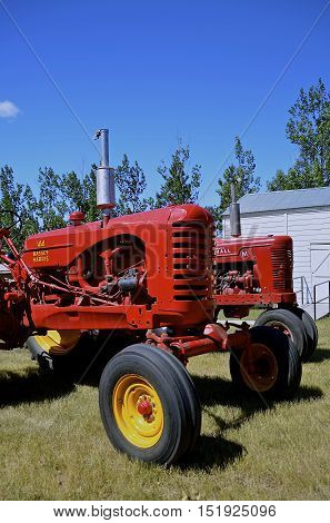 WATFORD CITY, NORTH DAKOTA, June 23, 2016: Vintage  Massey Harris and Formal M tractors are displayed at the Watford City Pioneer Museum which is open and free to the public.