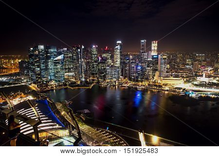 SINGAPORE - September 2016: Skyscrapers in financial district of Singapore skyline view from Marina Bay Sands. Singapore Marina Bay rooftop view with urban skyscrapers at night.