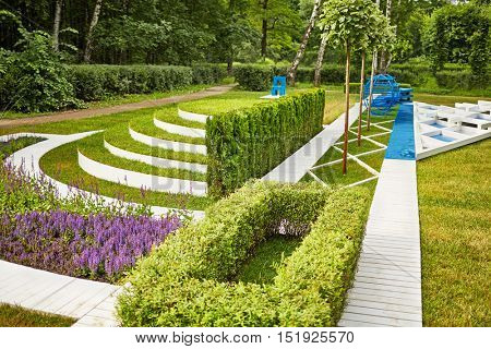Lawn in summer park, example of landscape disign.