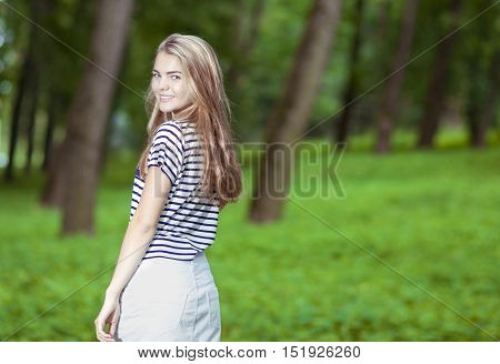 Teenagers Lifestyle Concepts. Portrait of Smiling Blond Caucasian Teenager Posing Outdors.Horizontal Image Composition