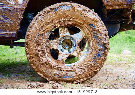 SUV tire has been mired in the mud