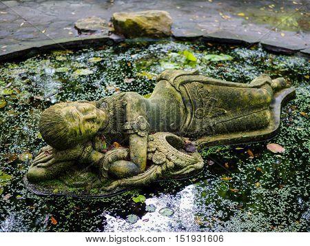 sleeping thai lady statue at Suan Nai Dum Chumphon Thailand