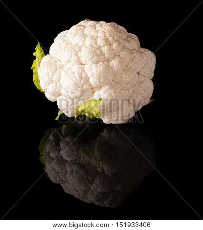 Cauliflower isolated on a black glossy background with real reflection
