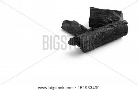 Black charcoal on white background, raw material for make cooking