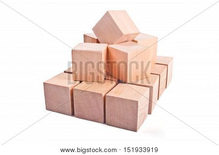 Wooden toy cubes for children's play isolated on white background
