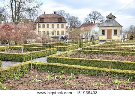 STOCKHOLM SWEDEN - May 04.2013: Ethnographic complex the open air museum Skansen located on Djurgarden Island in Stockholm. Flowerbeds are in a garden