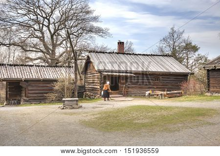 STOCKHOLM SWEDEN - May 04.2013: Ethnographic complex the open air museum Skansen located on Djurgarden Island in Stockholm. Dwelling-house and barn