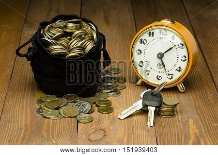 Watch Coins and Keys over a wood table
