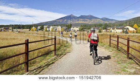 FLAGSTAFF, ARIZONA, OCTOBER 12. The Flagstaff Urban Trail on October12, 2016, in Flagstaff, Arizona. A Cyclist Family Rides on the Flagstaff Urban Trail in the Autumn in Flagstaff Arizona.