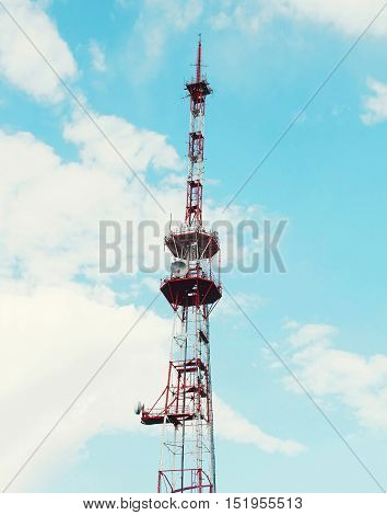 Telecommunication towers with antennas on a blue sky