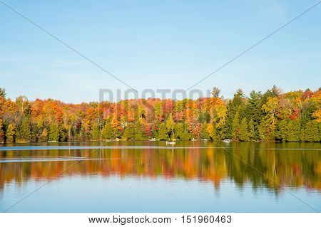 Autumn colors in Quebec Canada (Lac Saint-Amour in Sainte-Anne-des-Lacs)