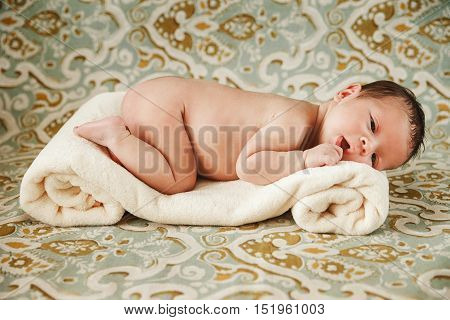 Beautifull Newborn Baby Girl is on the Soft Towel.Colorfull Background.
