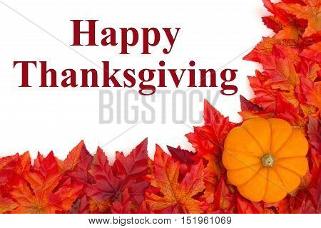 Happy Thanksgiving greeting Some fall leaves and a pumpkin with text Happy Thanksgiving