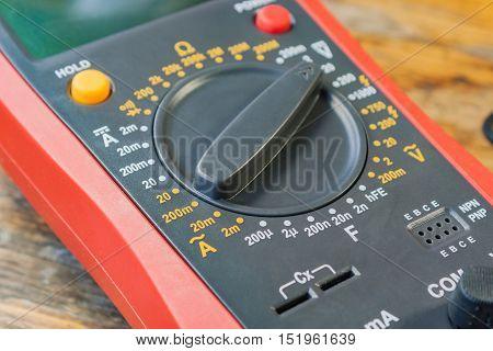 Digital multimeter on a table in a workshop