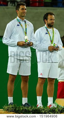 RIO DE JANEIRO, BRAZIL - AUGUST 12, 2016: Silver medalists Horia Tecau (L) and  Florin Mergea of Romania during medal ceremony after men's doubles final of the Rio 2016 Olympic Games