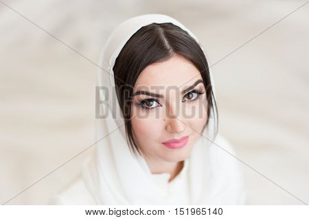 portrait of beautiful girl in white headscarf