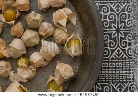ground cherries or tomatillos in an old plate