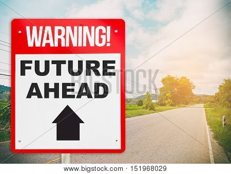 Warning sign with Future Ahead on a bright road.
