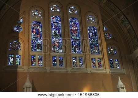 Lisieux France - September 7 2016: Inside the Basilica of Saint Therese of Lisieux in Normandy. Richly decorated with stained glass windows