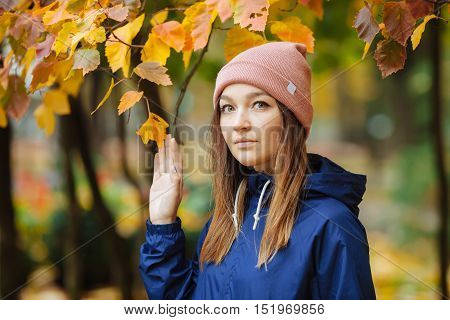 Stylish Sporty Brunette Woman Close Up In Trendy Urban Outwear Posing At Bridge Forest City Park On