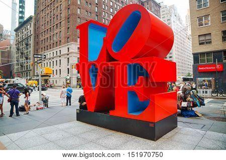 NEW YORK CITY - SEPTEMBER 5: Love sculpture at 55th street with tourists on September 5 2015 in New York City.