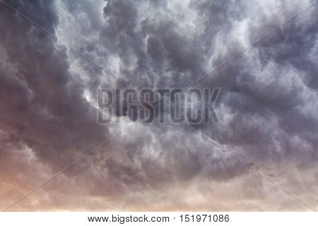Stormy sunset clouds background with cold and warm colors