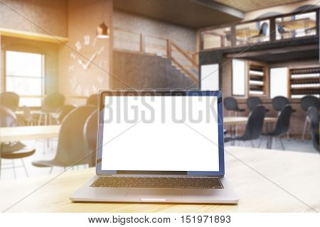 Restaurant interior with large clock on brick wall tables surrounded by chairs and laptop on the foreground. Concept of writer's work. Mock up. Toned image. 3d rendering