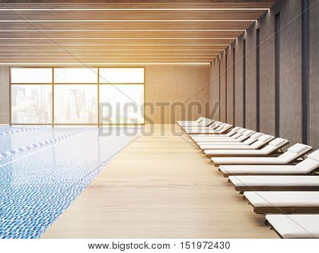 Sunlit public pool interior with chaise longues and wooden floor. City is seen through large windows. 3d rendering.