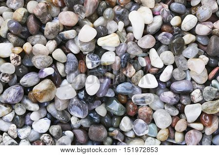 Closeup of various colorful stones quartz, marbles, ore minerals, gems use as ornament and decoration jewelry that contain spiritual force human believes
