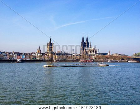 Cologne Germany - August 10 2016: Churches. St Martin Church and the great Cathedral of Cologne stand side by side in the skyline of Cologne.