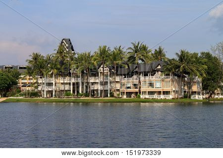 a Laguna Beach ResortPHUKET THAILAND - NOV 06 2013: Luxury villa with lagoon lake and palm around