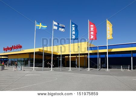 Haparanda, Sweden - July 20, 2016: Exterior of the Ikea furniture store near the border with Finland with bilingual entrance sign above the entrance.