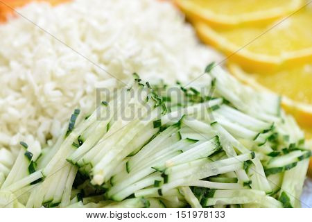 Different vegetables grated on a grater shaped. Culinary abstract background.