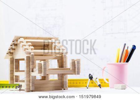 House on blueprints. Construction blueprints with tools and house.