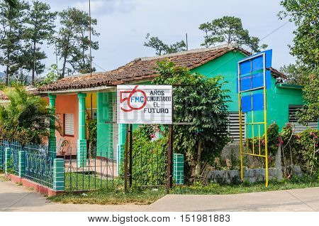 VINALES, CUBA - MARCH 19, 2016: House in the village with Communist propafanda in the Vinales Valley in Cuba