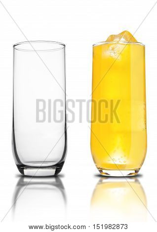 Glass of orange soda with ice cubes empty glass and bubbles with reflection on white background