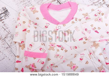 Baby goods hanging on the clothesline. Baby blouse and pants sliders pijama on the clothespin