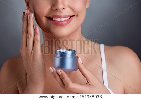 Beautiful middle-aged woman with renewal cream, cosmetic concept
