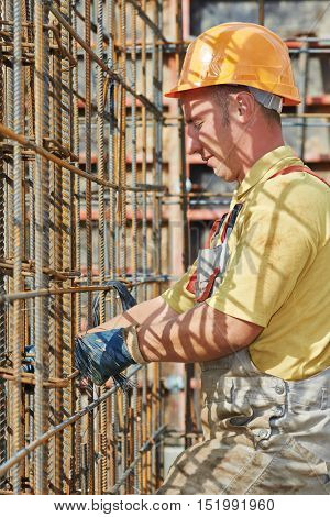 construction worker making reinforcement