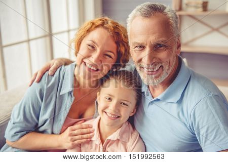 Grandparents And Little Girl At Home
