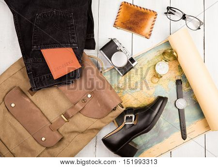 Watch, Camera, Glasses, Backpack, Shoe, Geographic Map, Passport, Compass, Purse On White Wooden Tab