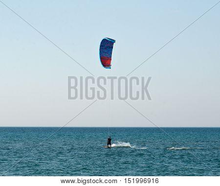 Water sport, kiteboarding on Lake Michigan in warm fall day