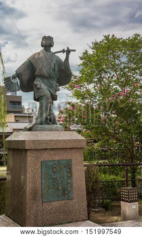 Kyoto Japan - September 16 2016: Izumo No Okuni statue at crossing of river and Gion neighborhood. She is the founder of the Kabuki dance at the start of 17th century.