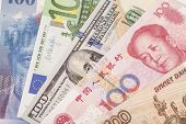 American dollars European euro Swiss franc Chinese yuan and Russian Ruble bills poster