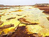 Sulphur lake Dallol in a volcanic explosion crater in the Danakil Depression northeast of the Erta Ale Range in Ethiopia. The lake with its sulphur springs is the hottest place on Earth. poster