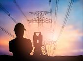 silhouette survey engineer working over Blurred high voltage transmission towers. poster