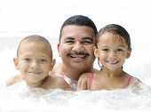 A happy father and his two kids spend some quality time in the jacuzzi. poster
