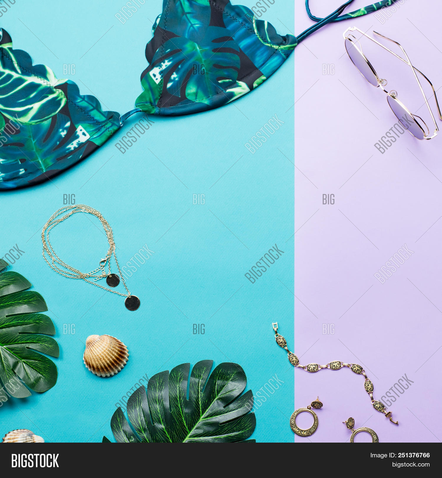 a7bbd944 Tropical bikini swimsuit and woman accessories, beach fashion. Traveler  accessories flat lay with female swimwear, palm leaves. top view